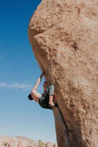 A man starting bouldering outside