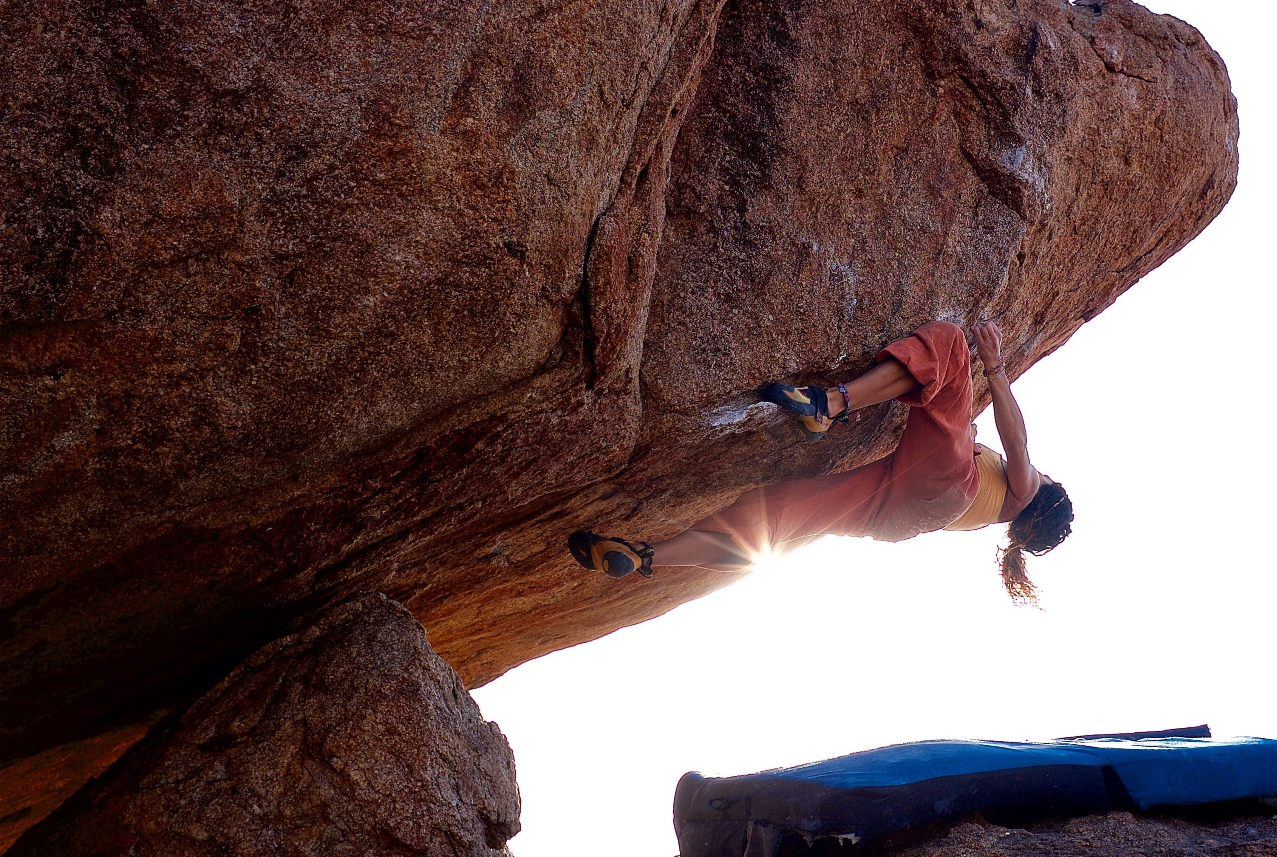 A woman bouldering outdoors