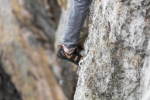Bouldering clothes and a rock