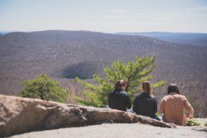 Friends sitting together after bouldering