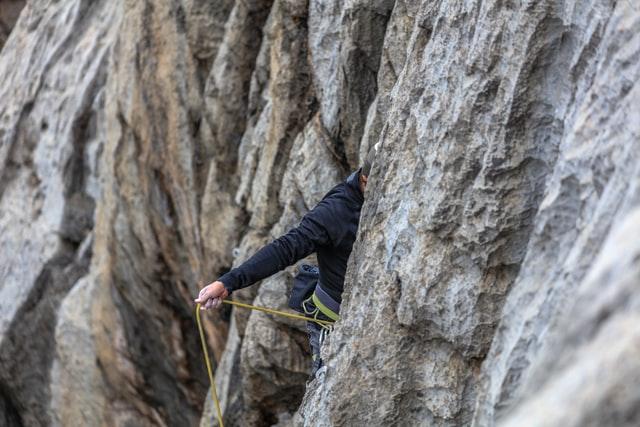A man sport climbing